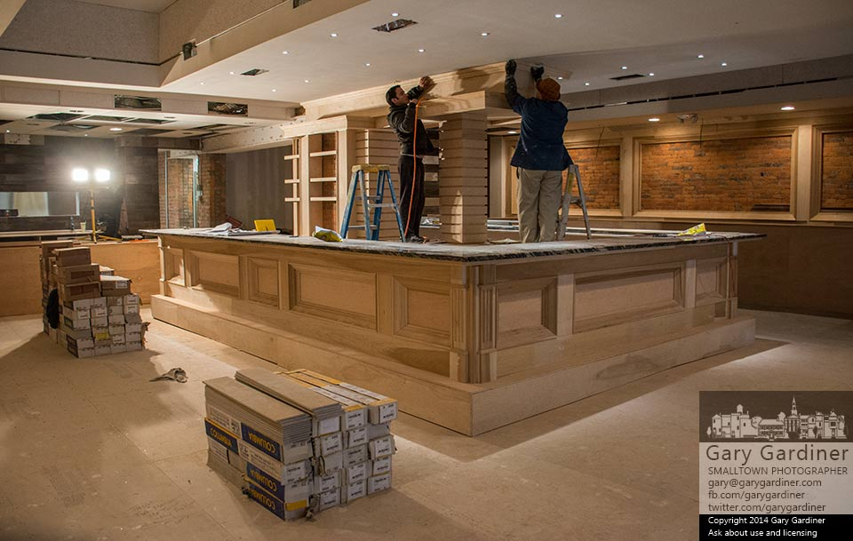Carpenters install crown molding over the bar at Koble, a Greek-Italian restaurant planned for North State Street in Westerville. My Final Photo for Nov. 14, 2014.