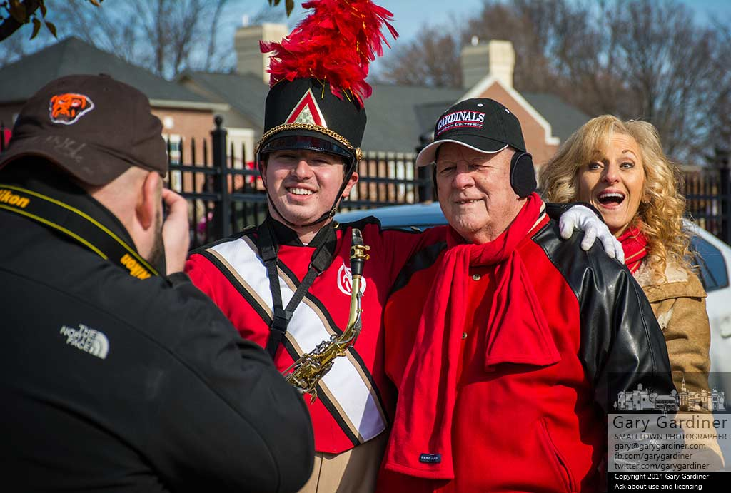A senior Otterbein University Marching Band member is photobombed while having his photo taken at Senior Day during the football game. My Final Photo for Nov. 15, 2014.