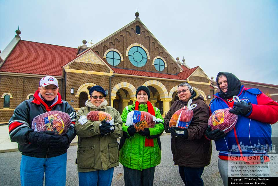Five volunteers pose with some of the nearly 400 turkeys collected for Holy Rosary St. John Community Kitchen at St. Paul Catholic Church Sunday. My Final Photo for Nov. 16, 2014.