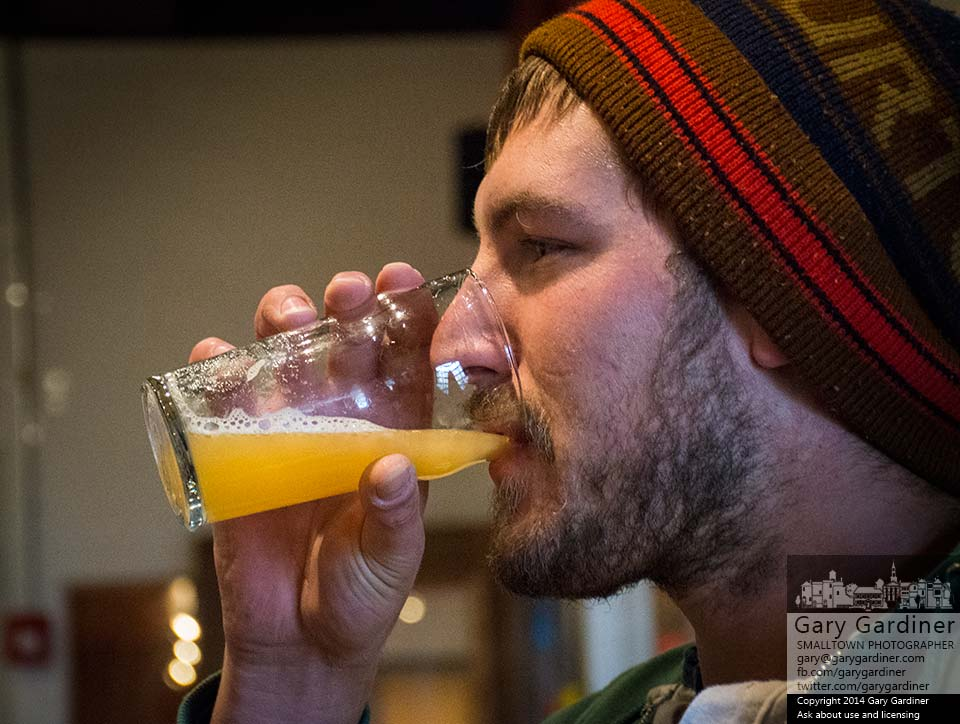 Brewer Alex Francis tastes an early sample of the first pale ale brewed at Temperance Row Brewing company inside The Uptown Deli. My Final Photo for Oct. 31, 2014.