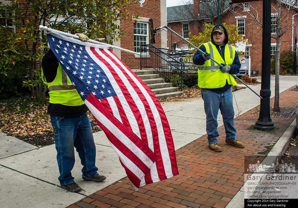 City workers remove flags from poles in Uptown Westerville the day after Veterans Day. My Final Photo for Nov. 12, 2014.