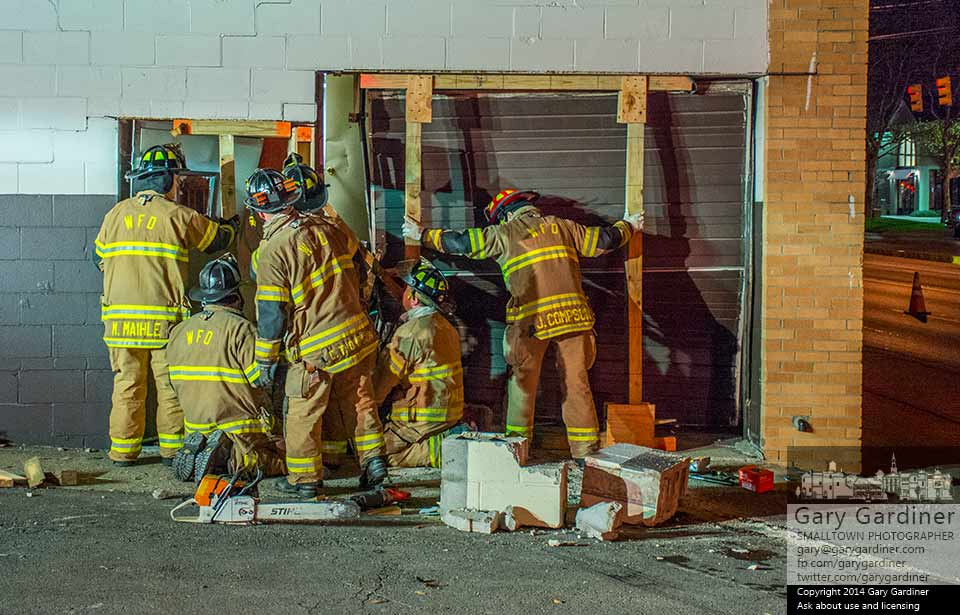 Westerville fire fighters build a support structure to keep the wall at the rear of Roush Hardware from collapsing after it was damaged when struck by a car. My Final Photo for Nov. 9, 2014.