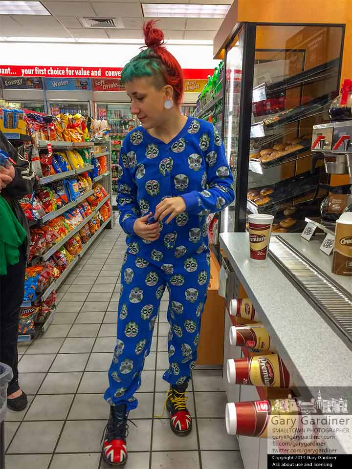 Avery  turns to talk with her mother before finishing her coffee selection at Speedway on South state Street on Christmas morning. My Final Photo for Dec. 25, 2014.