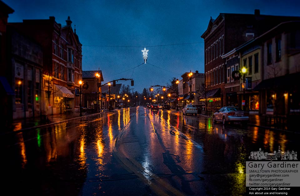 The Christmas Star and Uptown Westerville lights reflect in rain-slick streets. My Final Photo for Dec. 6, 2014.