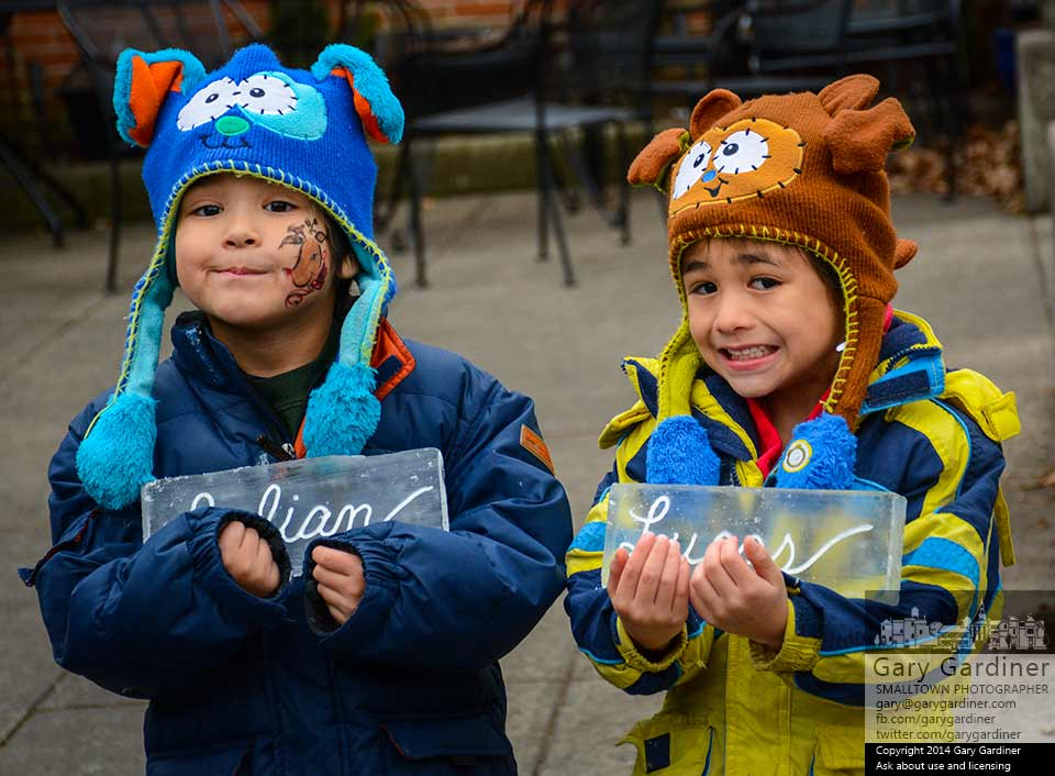 Brothers Julian and Lucas display blocks of ice with their names etched in script during an ice sculpture exhibit in Uptown Westerville. My Final Photo for Dec. 20, 2014.