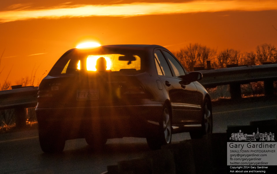 A commuter drives onto I-270 into the sunset on the last afternoon commute of 2014. My Final Photo for Dec. 31. 2014.