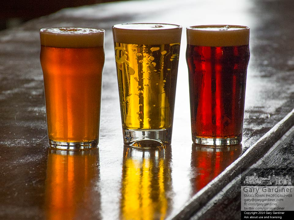 Three of the new beers at Temperance Row Brewing Company, from left, Scottish Ale, Pilsner, and the Christmas Ale, sit on the bar top during a taste test of the first drafts served before the brewery's opening next week. My Final Photo for Dec. 13, 2014.