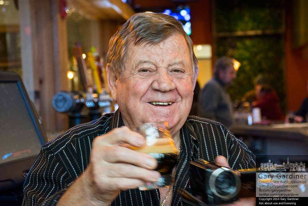 Joven Nedelkoski raises a beer in celebration to his son, Mario, as the opening of his restaurant and brewery in Uptown Westerville. My Final Photo for Dec. 17, 2014.
