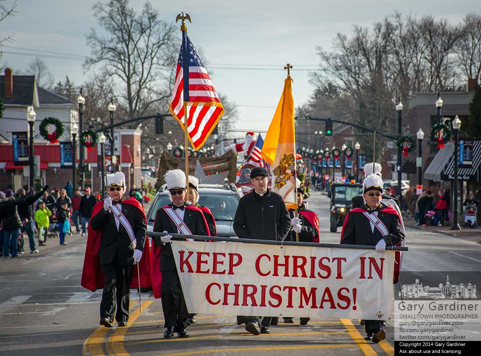 Fr. Michael Hinterschied, Associate Pastor at St. Paul the Apostle Catholic Church, and the Knights of Columbus precede Santa Claus in the Sertoma Children's Christmas parade in Westerville. My Final Photo for Dec. 7, 2014.