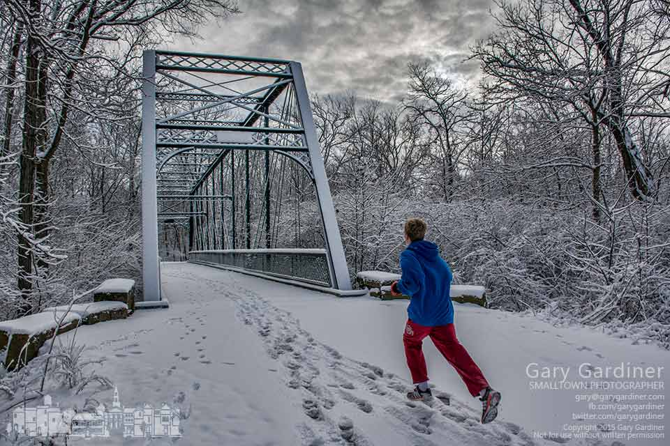 A runner approaches the snow covered truss bridge over Alum Creek on the bike path between Schrock and Main. My Final Photo for Jan. 26, 2015.