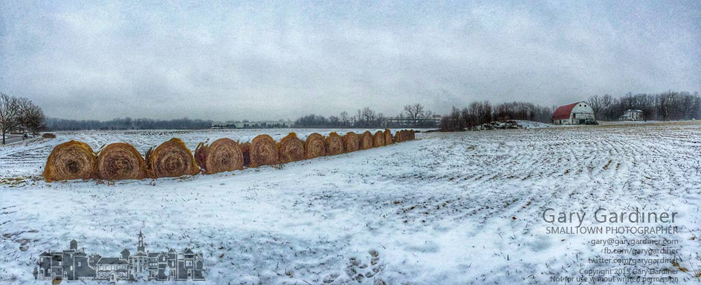 A layer of fresh snow and ice cover the fields and rolled bales of hay on the Braun Farm. My Final Photo for Jan. 12, 2015.