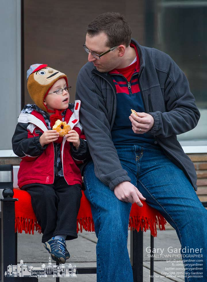 Father and son share a morning doughnut on the bench in front of Schneider's Bakery in Uptown Westerville before going to the public library. My Final Photo for Jan. 22, 2015.