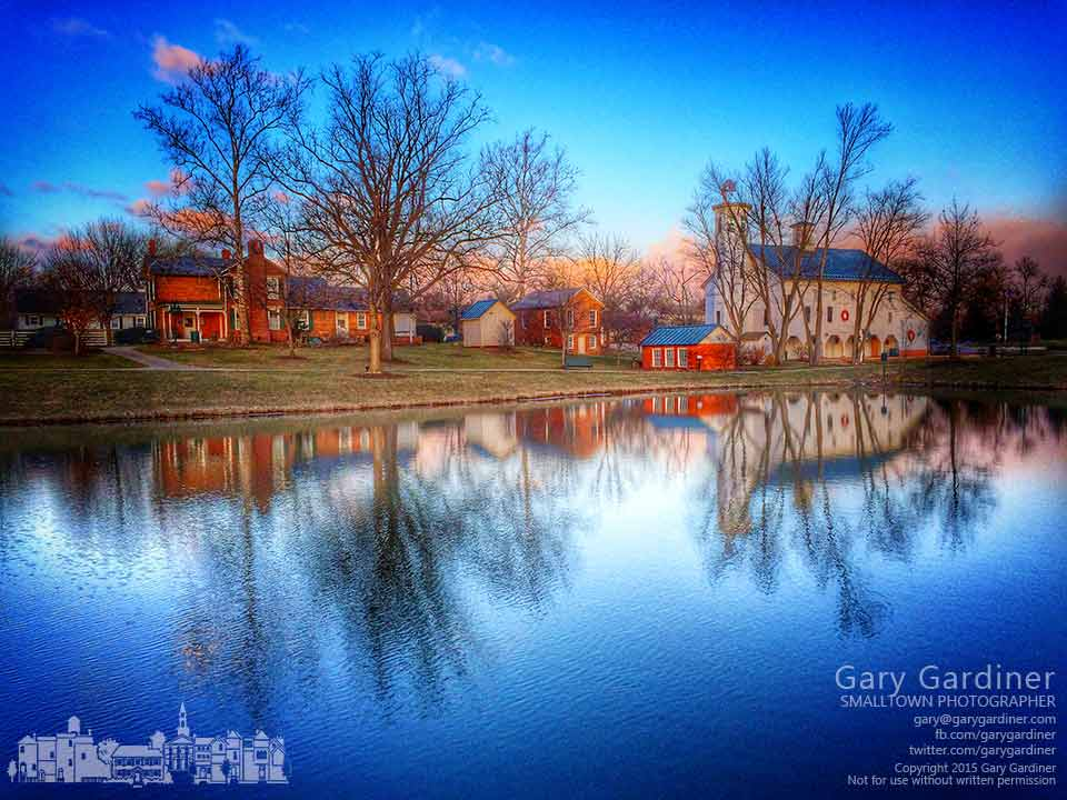 Reflecting in the4 pond the Everal Barn and Heritage Park buildings are lit by the sun on a crisp winter morning. My Final Photo for Jan. 5, 2015.