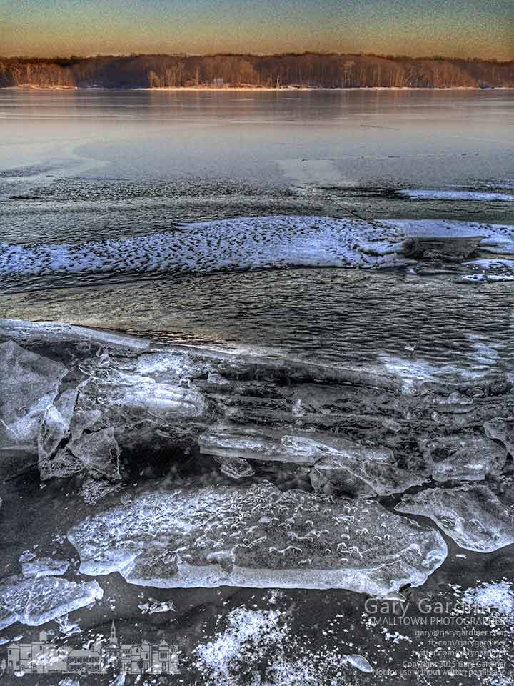 Ice cleaves along the shoreline of Hoover Reservoir as the lake level is lowered. My Final Photo for Jan. 15, 2015.
