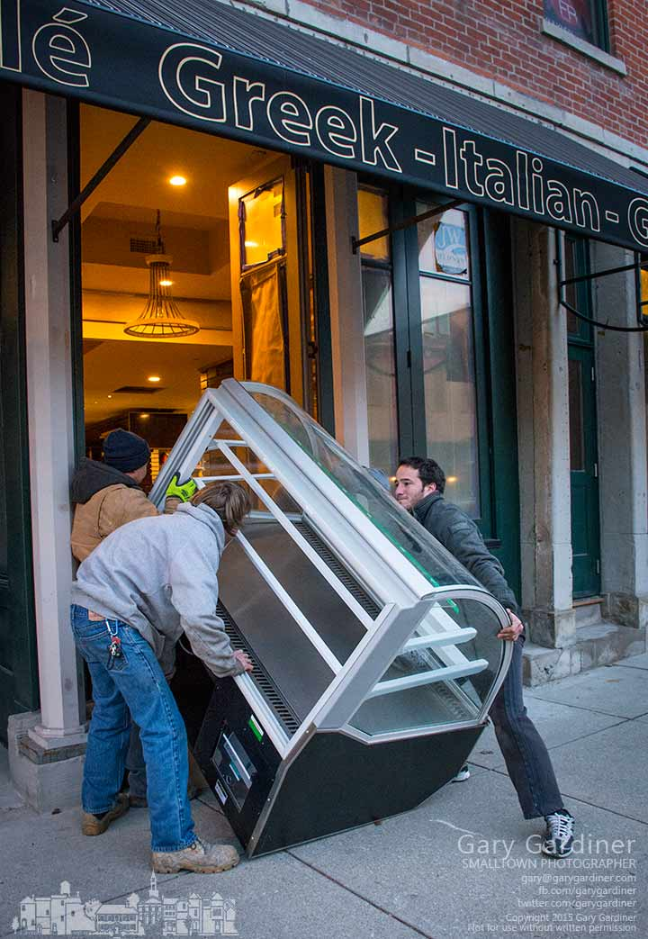 Workers struggle to lift the dessert cooler through the front window of Koble after discovering that it was too large to fit through any of the soon to open restaurant's doors. My Final Photo for Jan 2. 2015.