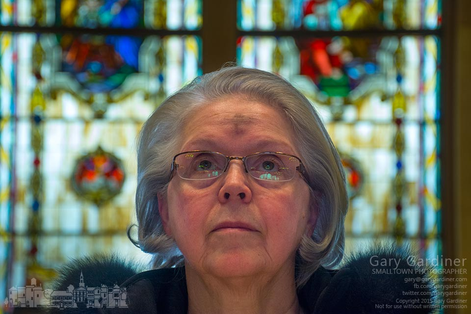 A woman stands in quiet prayer at the conclusion of the Ash Wednesday Mass at St. Paul Catholic Church in Westerville. My Final Photo for Feb. 18, 2015.