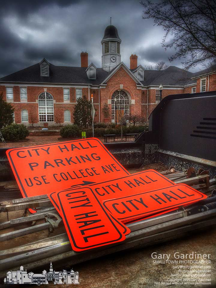 Signs to mark detours and directions for construction for a new parking lot behind city hall city in a truck across the street where workers installed the signs on the first day of construction. My Final Photo for Feb. 9, 2015.