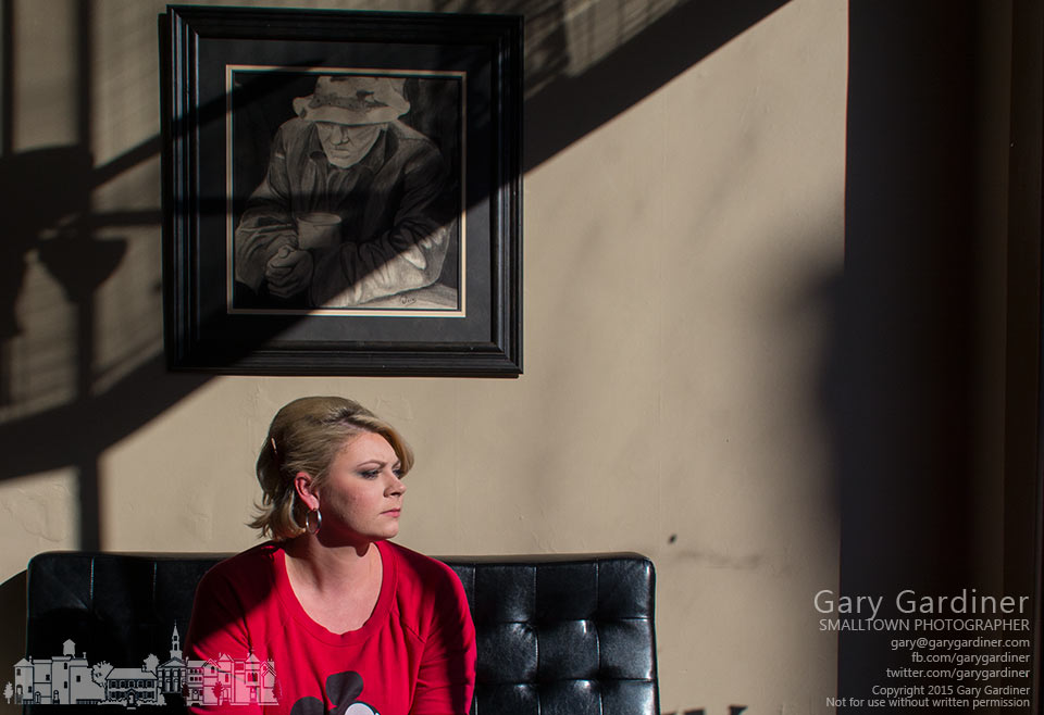 A beautician sits in the afternoon light of her lobby while waiting for her next client to arrive for an appointment. My Final Photo for Feb. 5, 2015.
