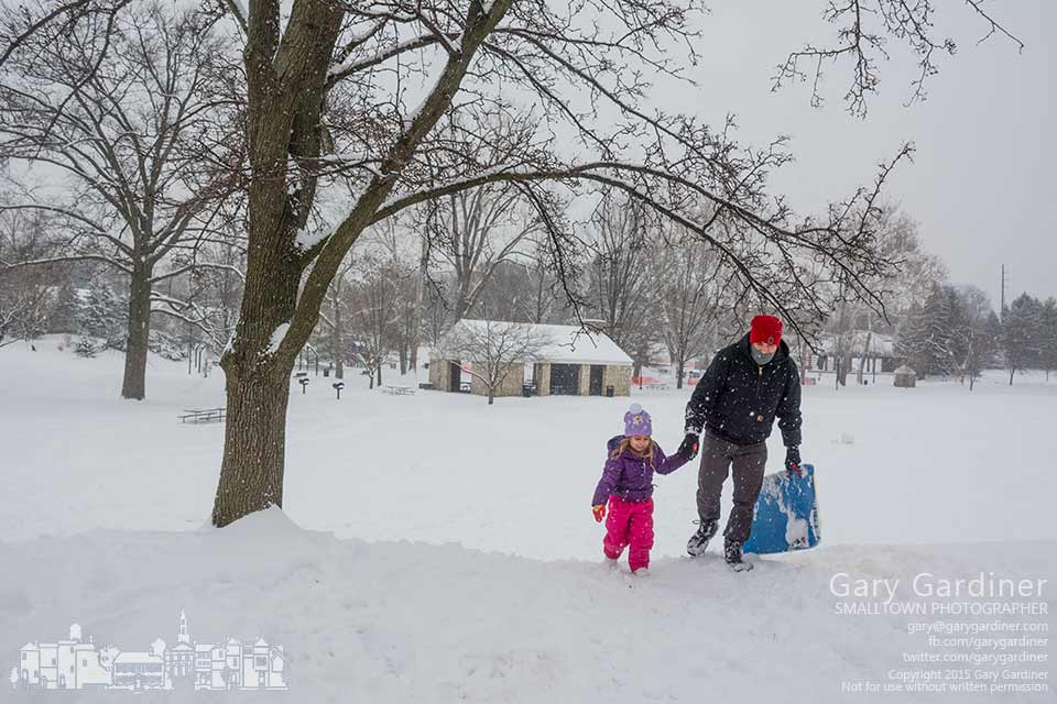 A father helps his daughter return to the top of the short sledding hill at Alum Creek Park where they enjoyed the sledding benefits of a heavy snow. My Final Photo for Feb. 21, 2015.