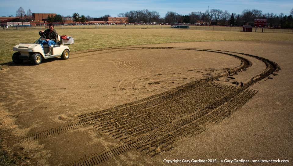 The baseball coach at Westerville South retreats after his tractor slid through mud on the infield while trying to get the field ready for practice delayed because of the wet winter. My Final Photo for March 15, 2015