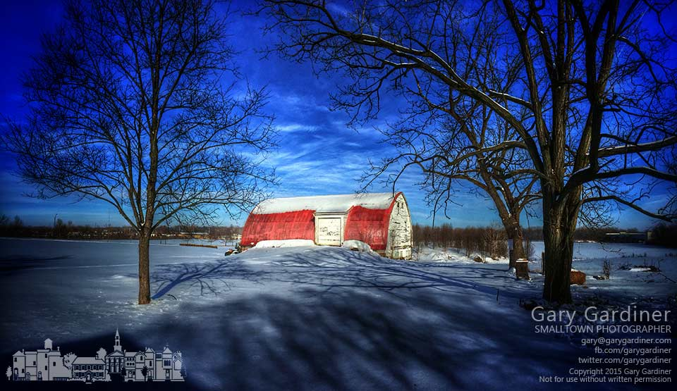 Afternoon sun casts walnut tree shadows across the ground in front of the red barn on the Braun Farm in Westerville in this iPhone photo. My Final Photo for March 2, 2015.