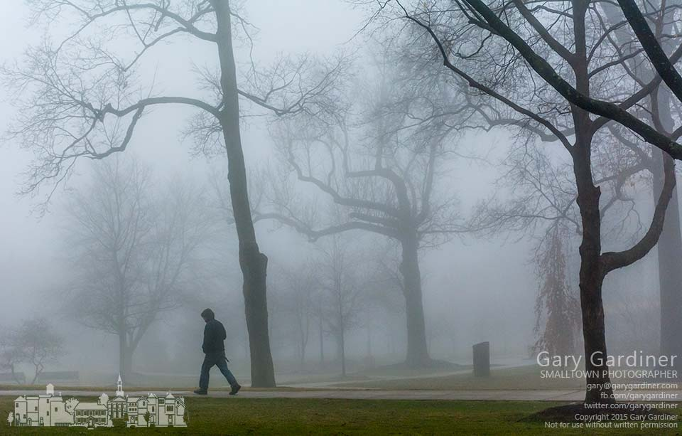 An Otterbein student walks to class in early morning fog as warmer temperatures melted snow. My Final Photo for March 11, 2015.