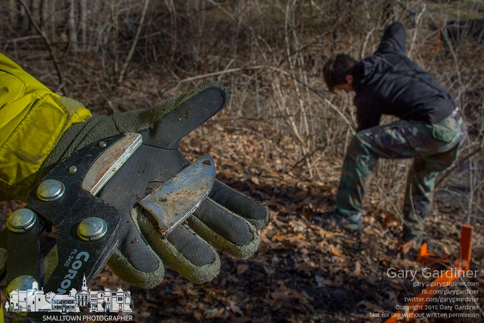 A volunteer displays the broken cutter on the tool he tried to use to cut honeysuckle from the riparian of a creek during an invasive species clearing operation in Westerville. My Final Photo for March 28, 2015.