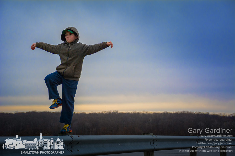Grandson Owen demonstrates his balance and martial arts prowess on a fence post at Hoover Reservoir. My Final Photo for March 29, 2015.