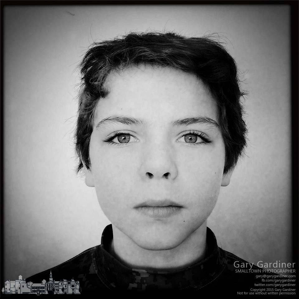 A young boy poses for an iPhone portrait. My final Photo for March 6, 2015.