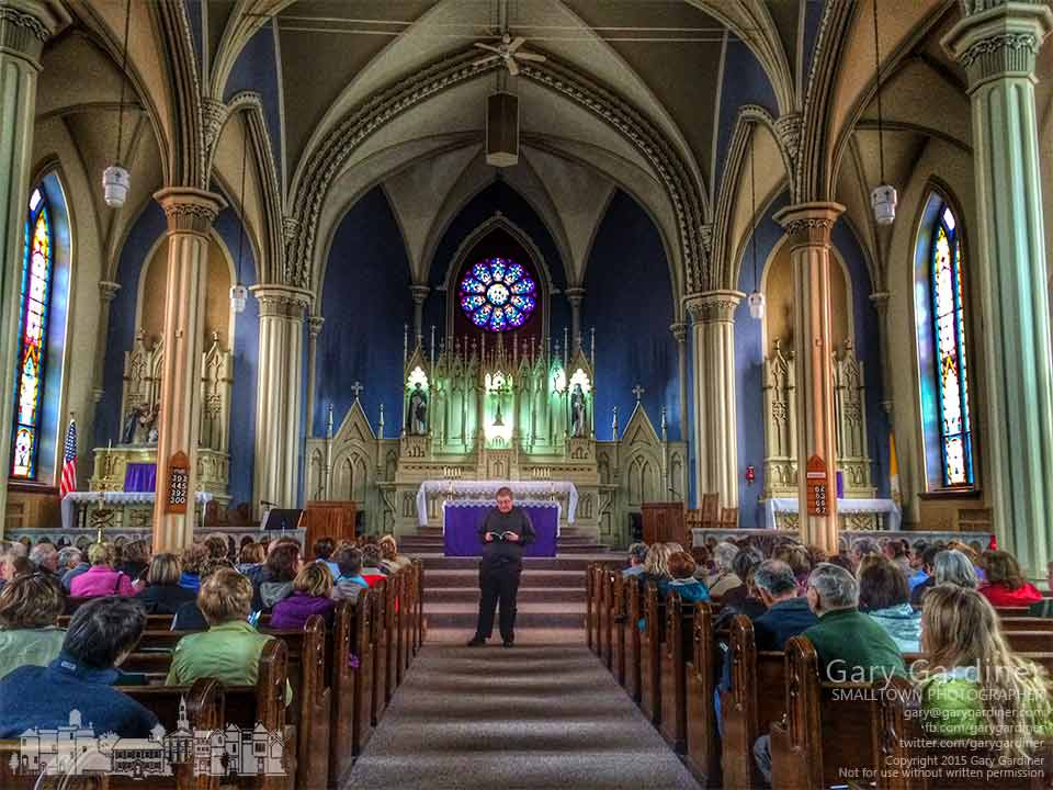 Father Josh Wagner explains some of the history of Holy Trinity Catholic Church in Somerset, OH to people traveling ion the Seven Church Tour visiting the oldest churches in the state. My Final Photo for March 21, 2015.