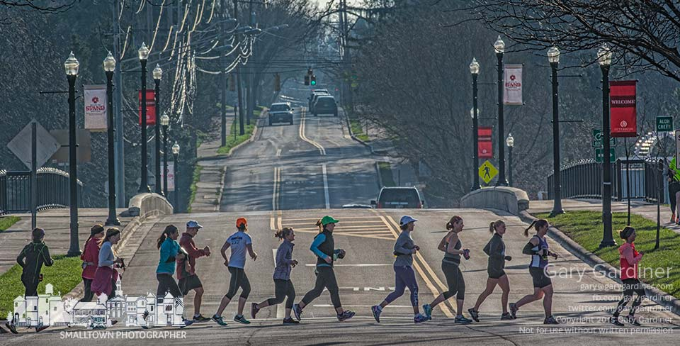 A collection of runners cross Main Street in their way to the walk path along Alum Creek early Saturday morning. My Final Photo for April 11, 2015.