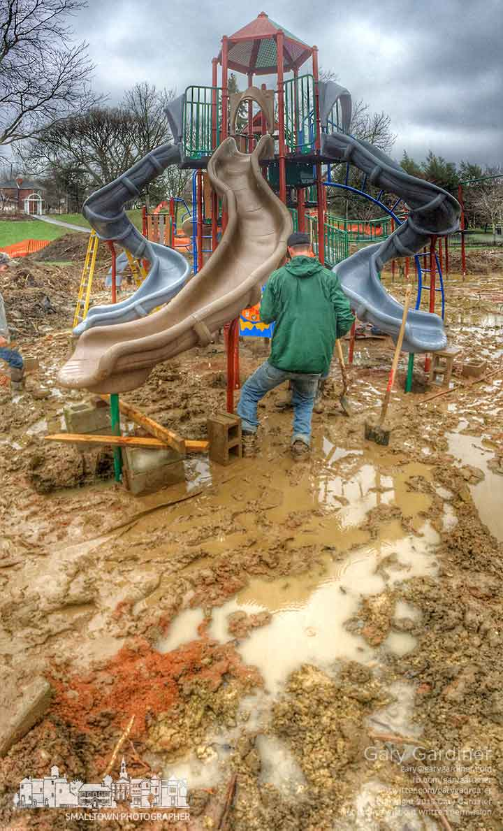 Westerville city workers struggle in the mud to erect new playground equipment in Alum Creek Park. My Final Photo for April 7, 2015.