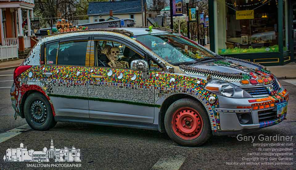 Westerville's most popular and well-known art car turns the corner at State and Main on its way to an afternoon meeting. My Final Photo for April 16, 2015.