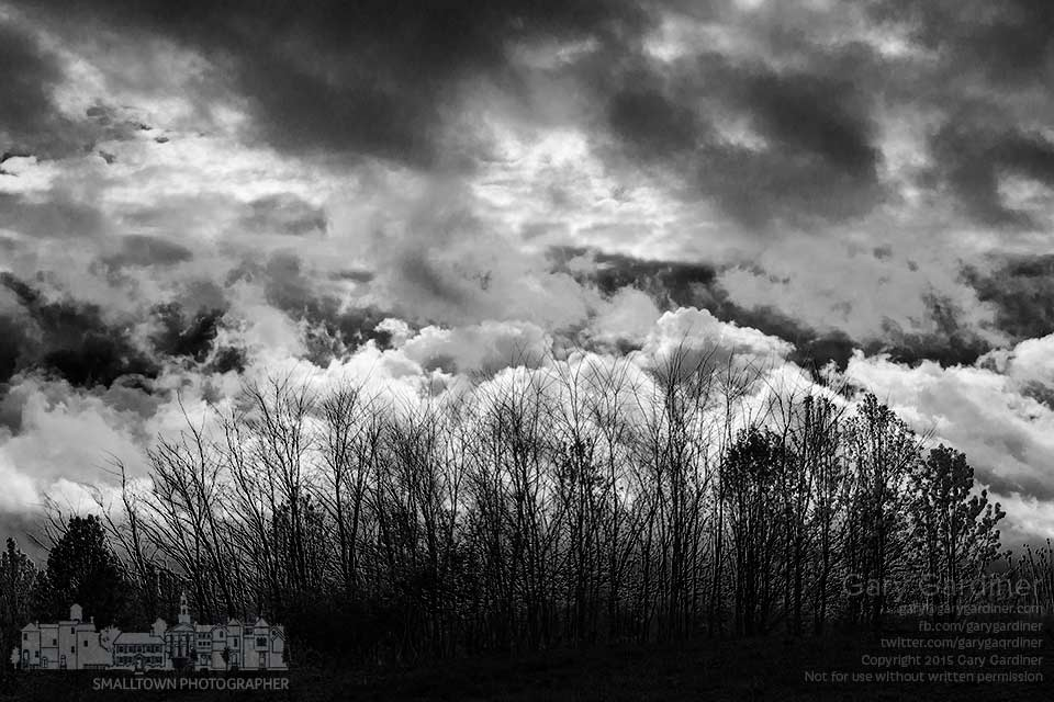 Morning storm clouds blow across a ridge-line of trees at the center of the Braun Farm in Westerville as rain brings cooler temperatures to the second half of April. My Final Photo for April 20, 2015.