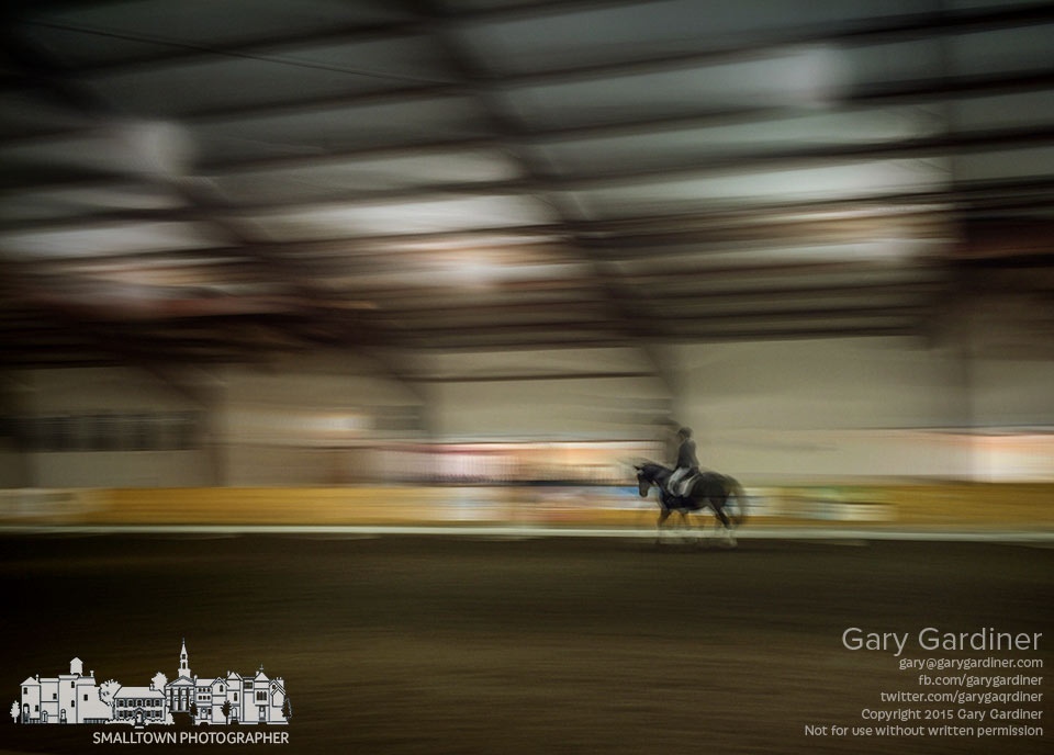 A rider guides her horse through compulsory movements during the Intercollegiate Dressage Association National Championship at Otterbein's Equestrian Center on North Spring. My Final Photo for April 25, 2015.
