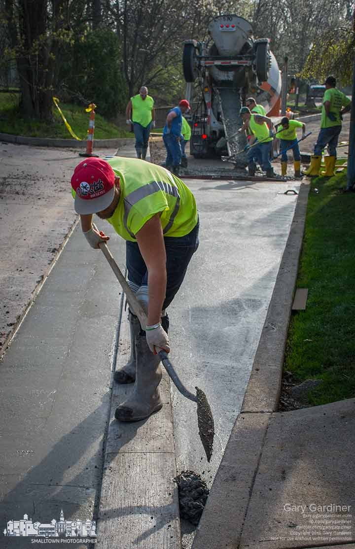 Workers lay 130 yards of concrete as the underlayer for the new brick pavers  that will be used to make a new driveway at the Westerville Library. My Final Photo for April 17, 2015.