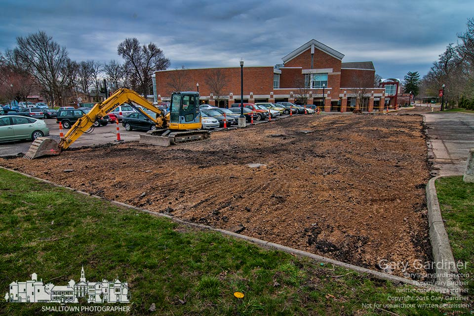 One section of the Westerville Library parking lot lies bare as work begins resurfacing the existing lot and driveway and adding new parking spot at the rear of the lot. My Final Photo for April 6, 2015.