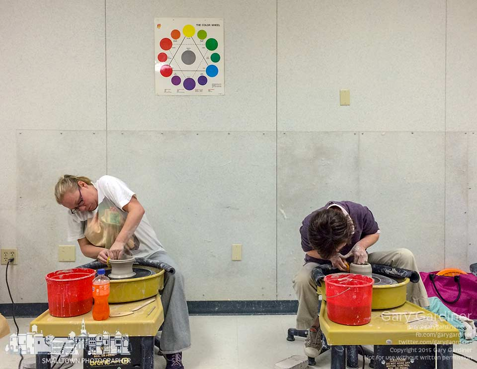 A pair of potters work to shape their clay into functional or artistic pieces during the Monday night classes at the city  parks offices. My final Photo for April 27, 2015.