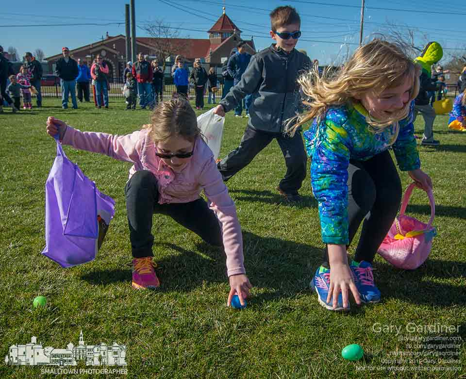 Three youngsters reach for the next in a series of eggs collected during the annual Easter egg hunt at St. Paul Catholic Church in Westerville. My Final Photo for April 4, 2015.