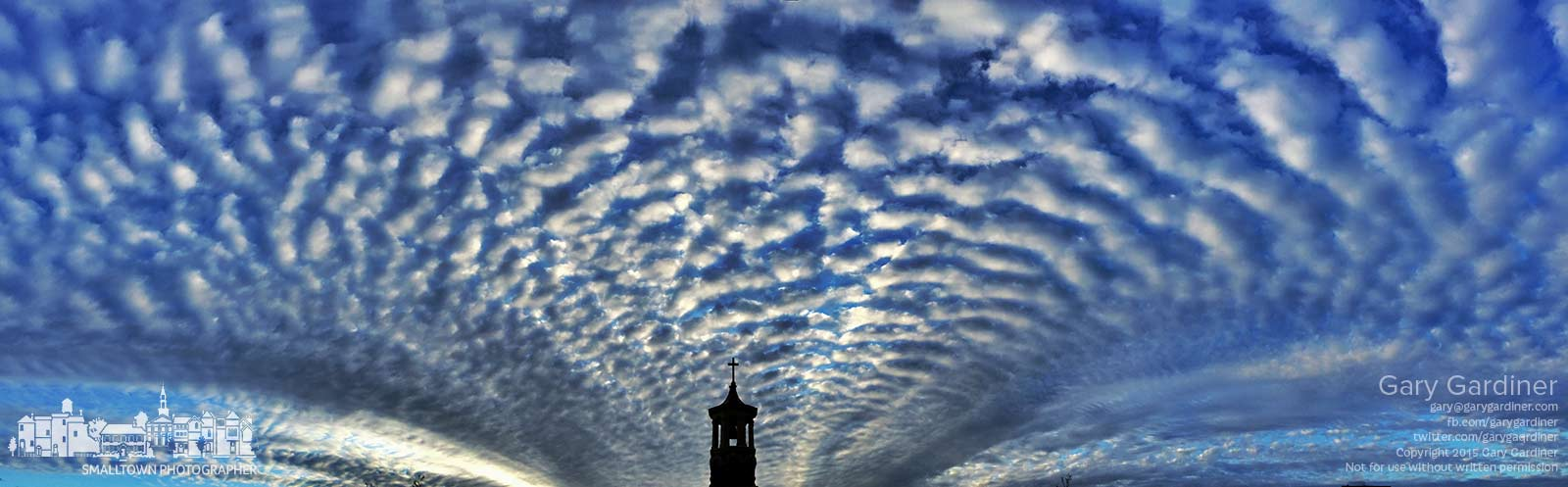 A blanket of clouds covers the sky at sunrise over the original church steeple for St. Paul Catholic Church. My Final Photo for April 27, 2015.