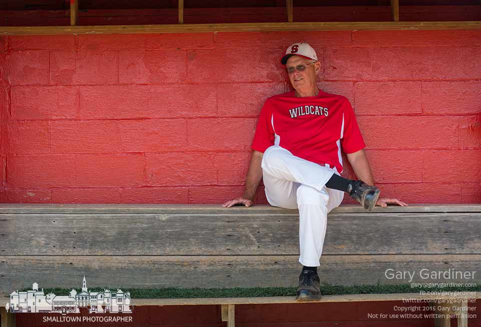 A Westerville South baseball coach relaxes in the dugout just before warmups began for a game against Olentangy Orange. My Final Photo for May 8, 2015.