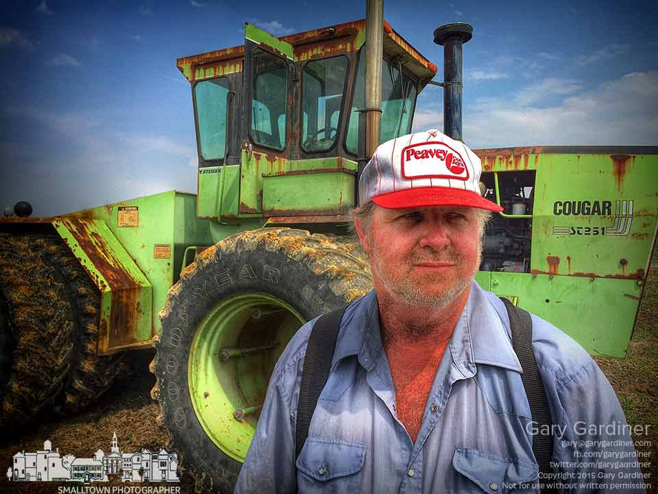 Farmer Tom stands beside the tractor he's using to spread lime across the fields at the Braun Farm along Cooper Rd. before planting this season's crop of soybeans. My Final Photo for May 11, 2015.