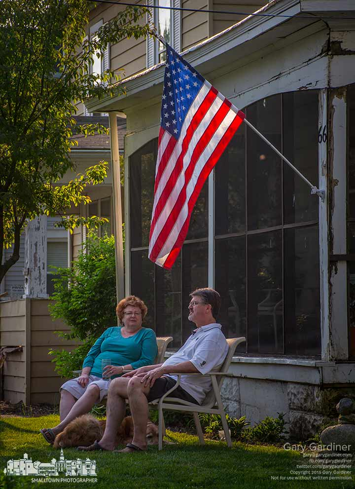 A couple enjoy the warm evening light sitting in their front yard in old Uptown Westerville. My Final Photo for May 7, 2015.