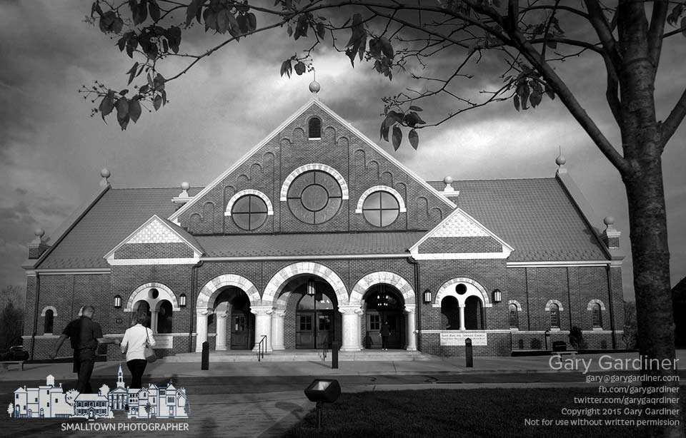 The morning sun brightens the front of St. Paul Catholic Church as parishioners arrive for the first Mass on Sunday. My Final Photo for May 3, 2015.