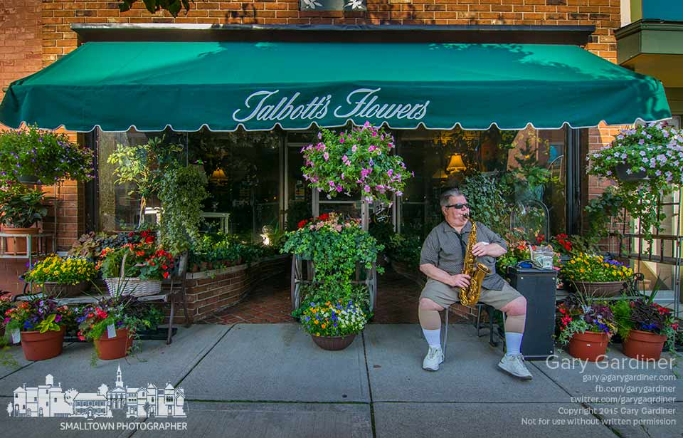 Saxophonist Larry Burgess plays from a metal chair in front of Talbott's Flowers on Unplugged Friday in Uptown Westerville. My Final Photo for May 15, 2015.