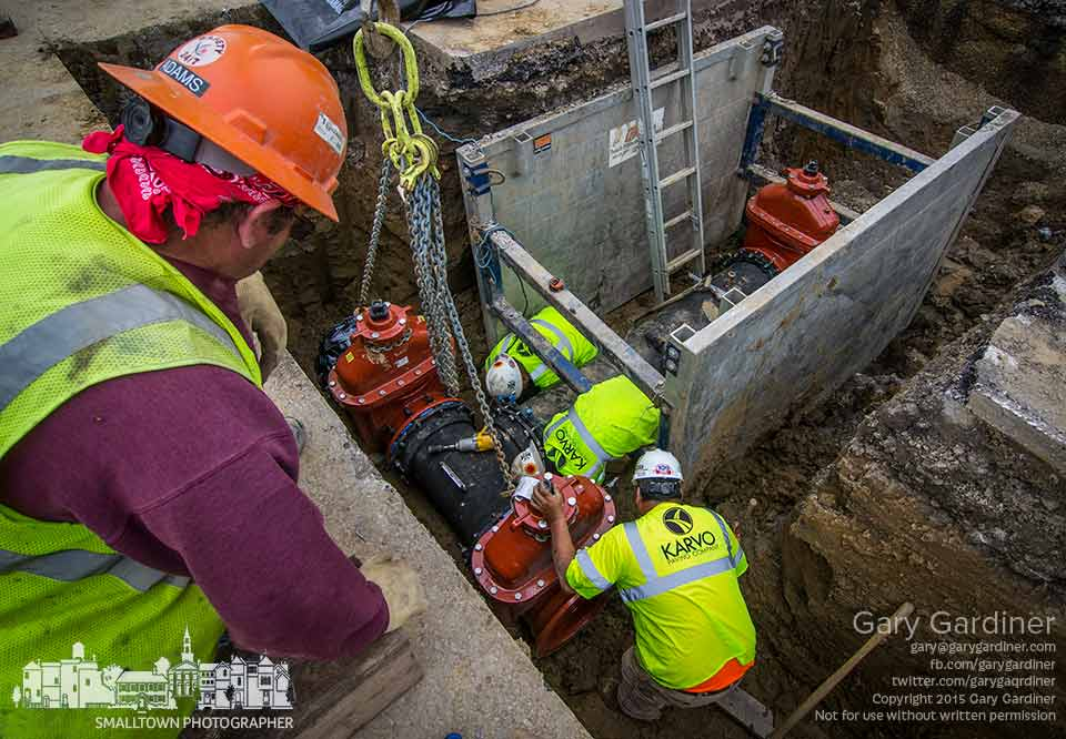 Construction workers install new water pipes beneath Schrock Road in the first phase of a n almost three year project to update the intersection of Schrock and State and the intersecting roadways. My Final Photo for June 2, 2015.