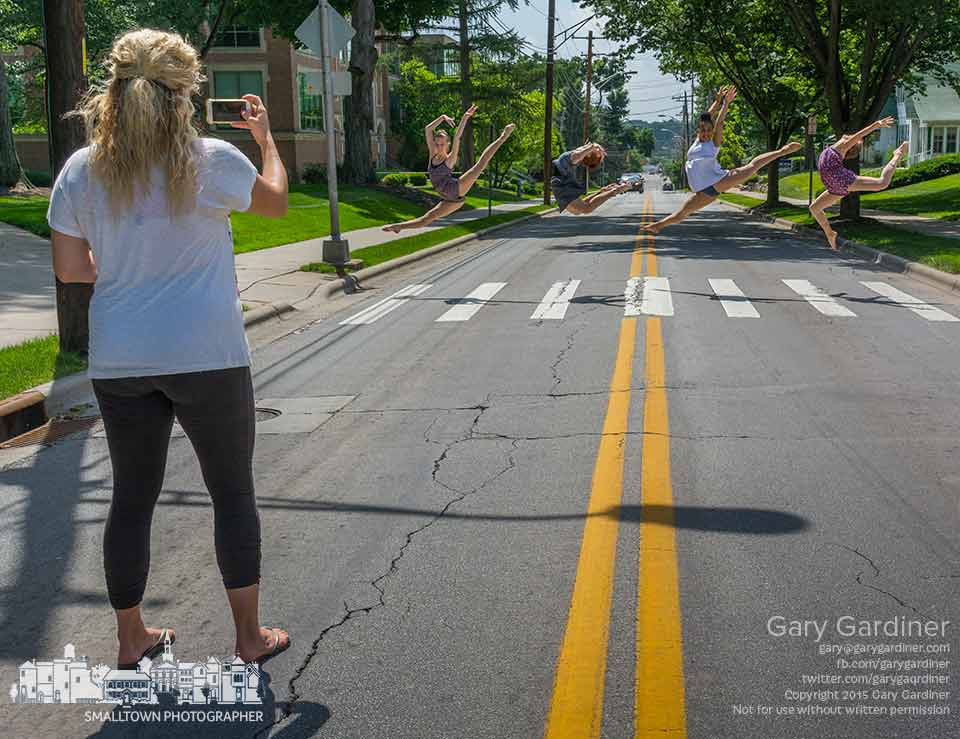 Jazmine Pfeifer of Generations Performing Arts Center photographs four of her dancers who leap in the crosswalk on Main St. at Otterbein University. My Final Photo for June 18, 2015.