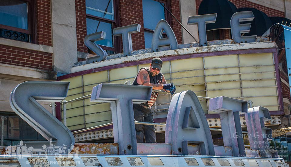 A worker waits for assistance to remove the second of two State Theater signs for the first stage of refurbishing the Uptown Westerville icon in time for the July 4th parade in advance of the 8 State Bistro opening this fall. My Final Photo for June 4, 2015.