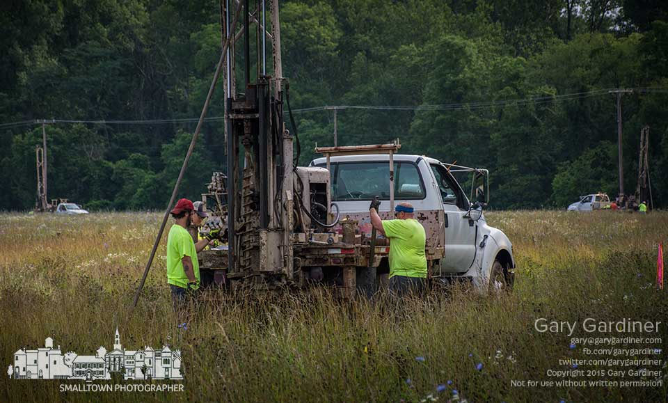 Three boring crews work to complete gathering soil samples from the hay field along the edge of the Braun Farm off Cooper Road before the holiday weekend. My Final Photo for July 2, 2015.
