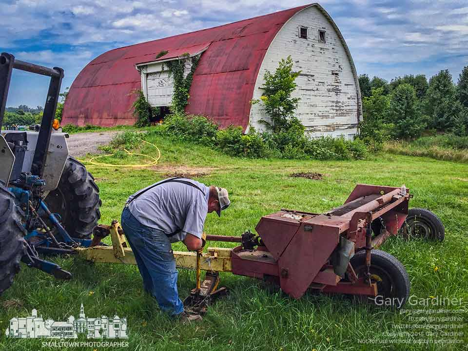 Farmer Tom uses a hydraulic jack to raise the drive shaft for a mower he planned to use to cut weeds and grass around the edge of the Braun Farm. My Final Photo for July 27, 2015.